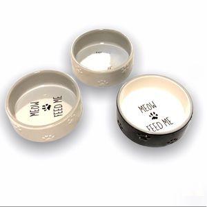 Three Cat Food Bowls